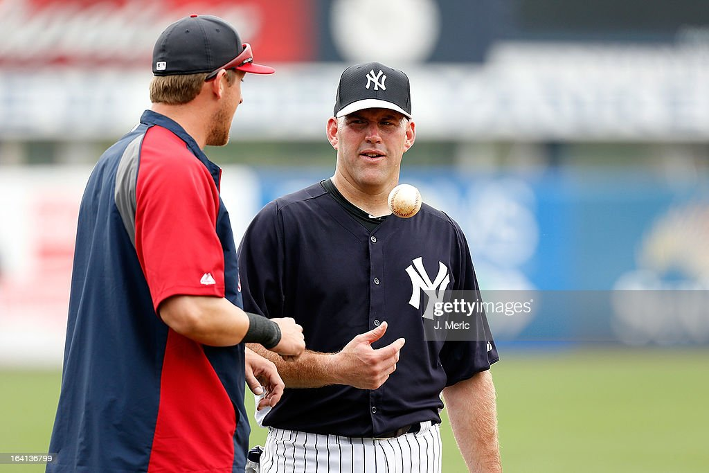 Infielder <a gi-track='captionPersonalityLinkClicked' href=/galleries/search?phrase=Kevin+Youkilis&family=editorial&specificpeople=206888 ng-click='$event.stopPropagation()'>Kevin Youkilis</a> #36 of the New York Yankees talks with outfielder <a gi-track='captionPersonalityLinkClicked' href=/galleries/search?phrase=Ryan+Sweeney+-+Joueur+de+baseball&family=editorial&specificpeople=711121 ng-click='$event.stopPropagation()'>Ryan Sweeney</a> #25 of the Boston Red Sox just before a Grapefruit League Spring Training Game at George M. Steinbrenner Field on March 20, 2013 in Tampa, Florida.