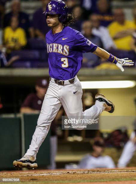 LSU infielder Kramer Robertson crosses home plate in the first inning during the Baton Rouge Division I Super Regional game between Mississippi St...