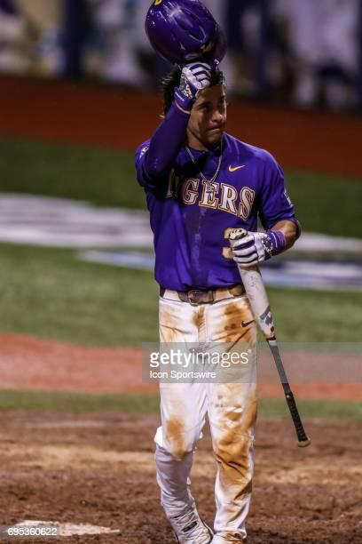 LSU infielder Kramer Robertson tips his helmet to the fans as he steps to the plate for the final time during the Baton Rouge Division I Super...