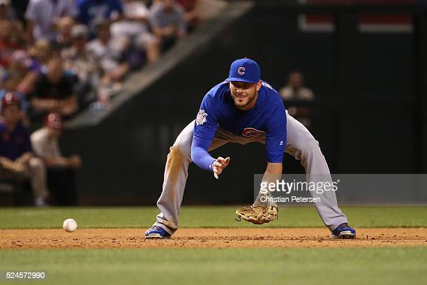Infielder Kris Bryant of the Chicago Cubs fields a ground ball out during the MLB game against the Arizona Diamondbacks at Chase Field on April 7...
