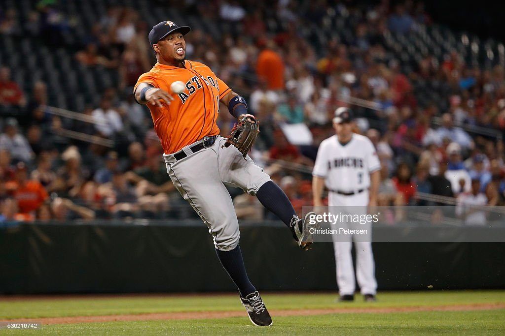 Infielder <a gi-track='captionPersonalityLinkClicked' href=/galleries/search?phrase=Luis+Valbuena&family=editorial&specificpeople=5537111 ng-click='$event.stopPropagation()'>Luis Valbuena</a> #18 of the Houston Astros fields a ground ball out against the Arizona Diamondbacks during the first inning of the MLB game at Chase Field on May 31, 2016 in Phoenix, Arizona.