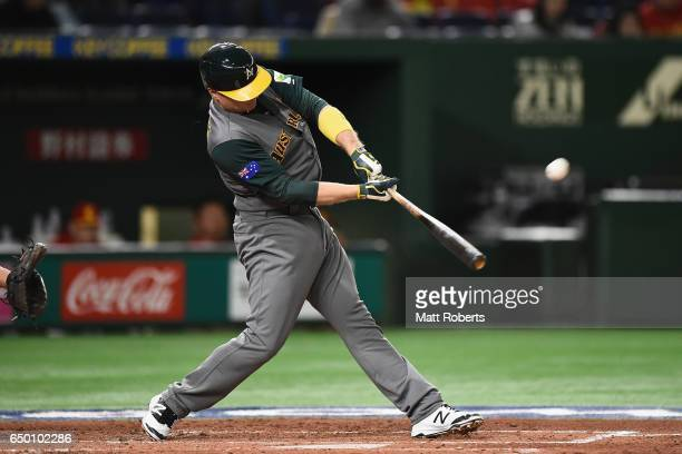 Infielder Luke Hughes of Australia hits a two run homer in the top of the third inning to make it 20 during the World Baseball Classic Pool B Game...