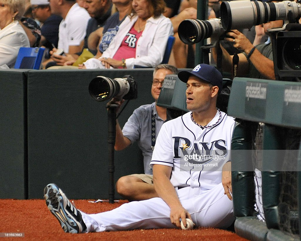 Infielder Luke Scott #30 of the Tampa Bay Rays watches play against the Baltimore Orioles September 23, 2013 at Tropicana Field in St. Petersburg, Florida.
