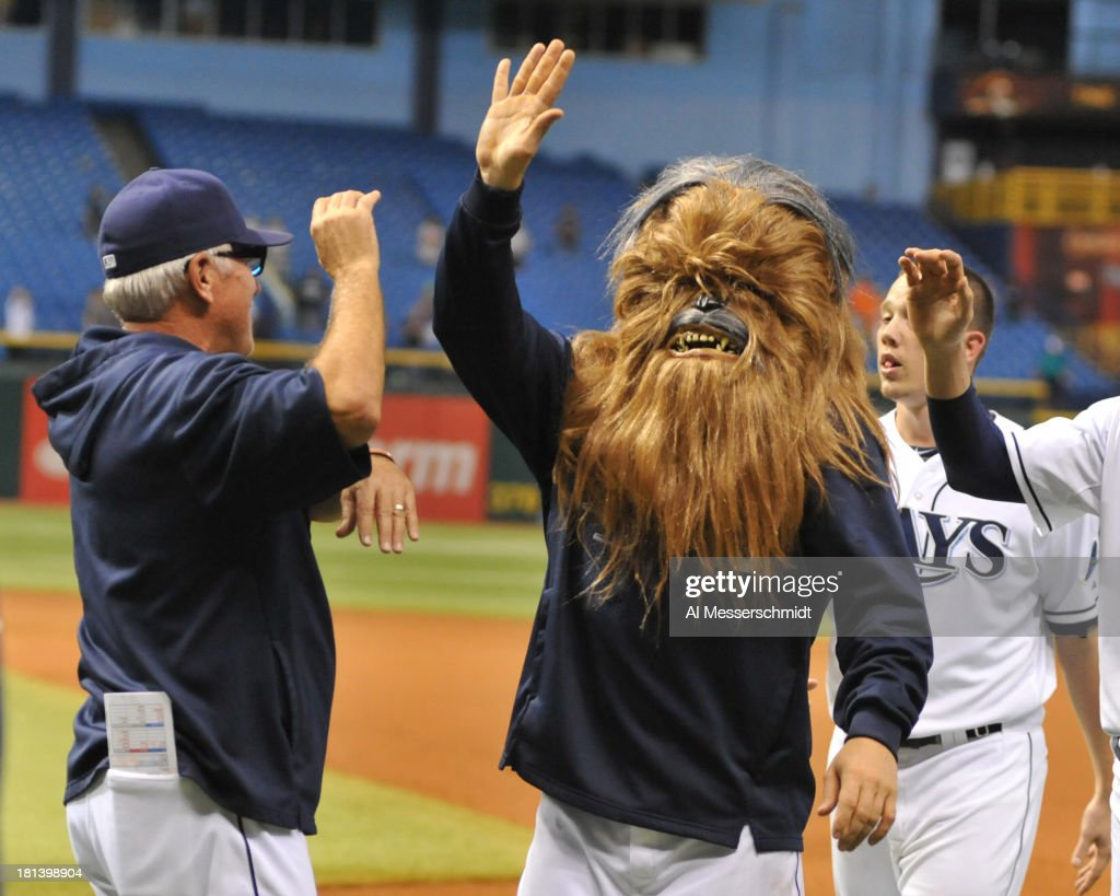 Infielder Luke Scott of the Tampa Bay Rays wears a Chewbacca mask during a celebration after a 5 -4 win in 18 innings against the Baltimore Orioles September 20, 2013 at Tropicana Field in St. Petersburg, Florida.