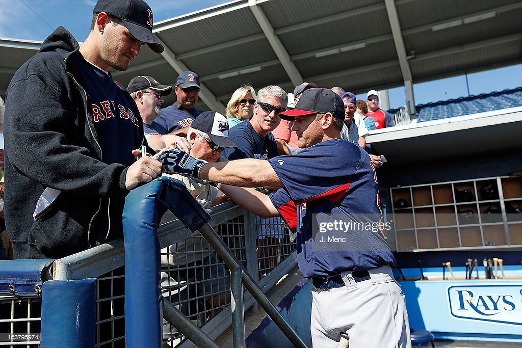 Infielder Lyle Overbay #35 of the Boston Red Sox signs an autograph just before the start of the Grapefruit League Spring Training Game against the Tampa Bay Rays at the Charlotte Sports Complex on March 16, 2013 in Port Charlotte, Florida.