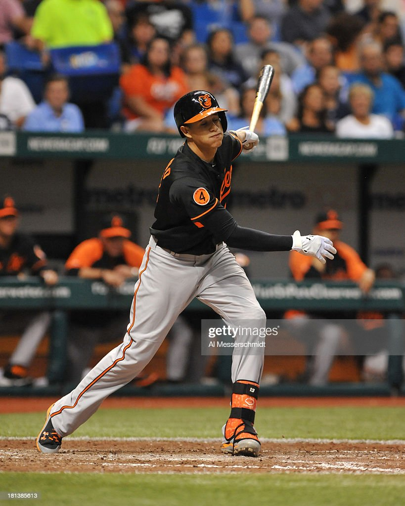 Infielder Manny Machado #13 of the Baltimore Orioles bats against the Tampa Bay Rays September 20, 2013 at Tropicana Field in St. Petersburg, Florida.