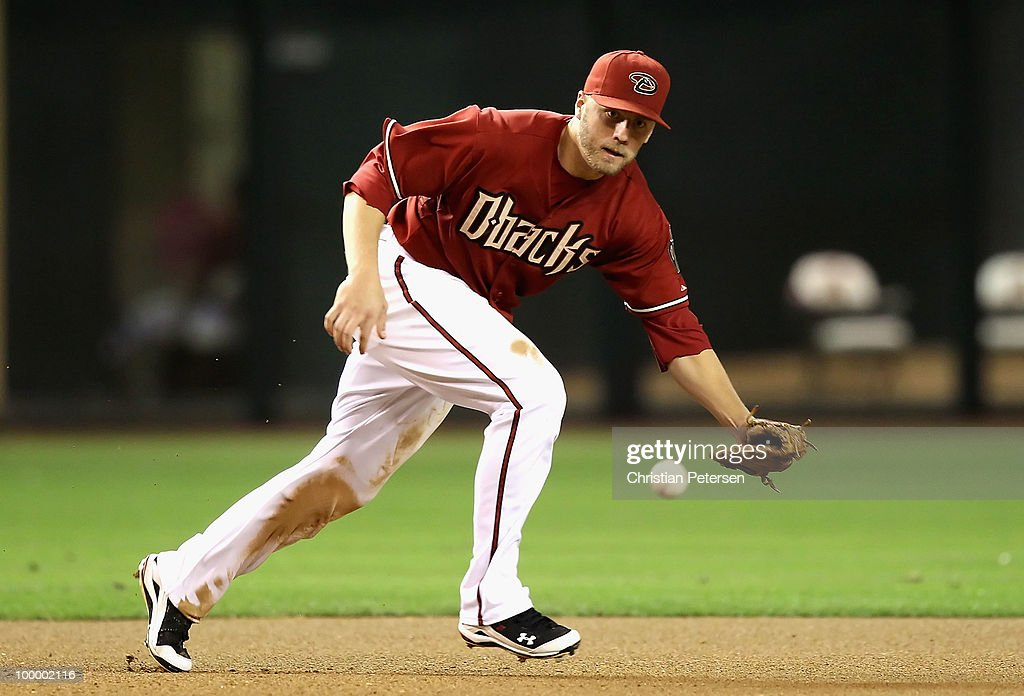 Infielder Mark Reynolds #27 of the Arizona Diamondbacks fields a ground ball out against the San Francisco Giants during the Major League Baseball game at Chase Field on May 19, 2010 in Phoenix, Arizona.