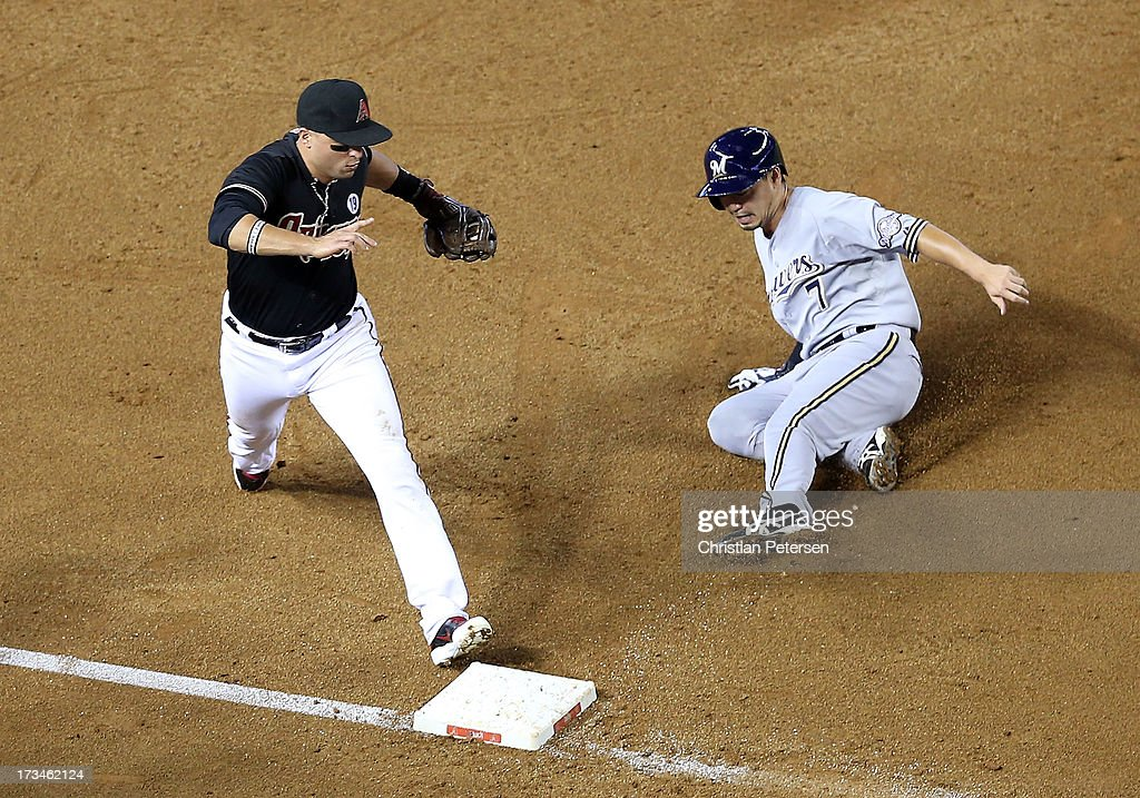 Infielder <a gi-track='captionPersonalityLinkClicked' href=/galleries/search?phrase=Martin+Prado&family=editorial&specificpeople=620159 ng-click='$event.stopPropagation()'>Martin Prado</a> #14 of the Arizona Diamondbacks forces out <a gi-track='captionPersonalityLinkClicked' href=/galleries/search?phrase=Norichika+Aoki&family=editorial&specificpeople=850957 ng-click='$event.stopPropagation()'>Norichika Aoki</a> #7 of the Milwaukee Brewers at third base during the MLB game at Chase Field on July 14, 2013 in Phoenix, Arizona. The Brewers defeated the Diamondbacks 5-1.