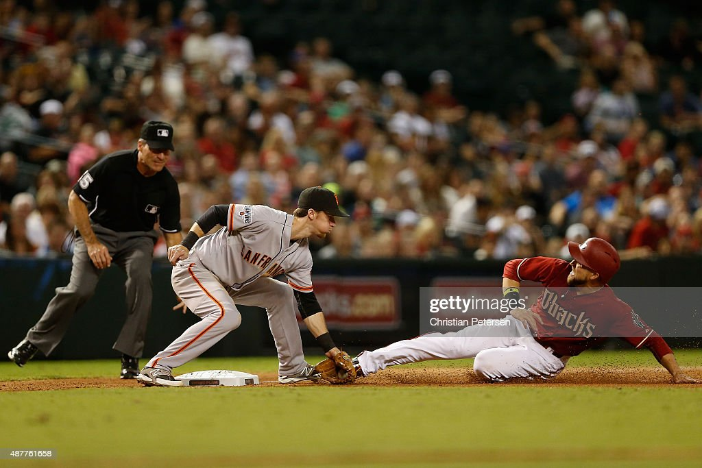 Infielder Matt Duffy of the San Francisco Giants tags out Ender Inciarte of the Arizona Diamondbacks as he attempts to steal third base during the...