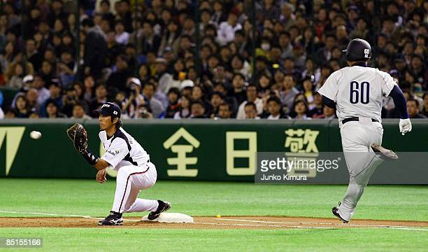 Infielder Michihiro Ogasawara of Japan tags out Infielder Takeya Nakamura of Saitama Seibu Lions during a friendly match between Japan and Saitama...