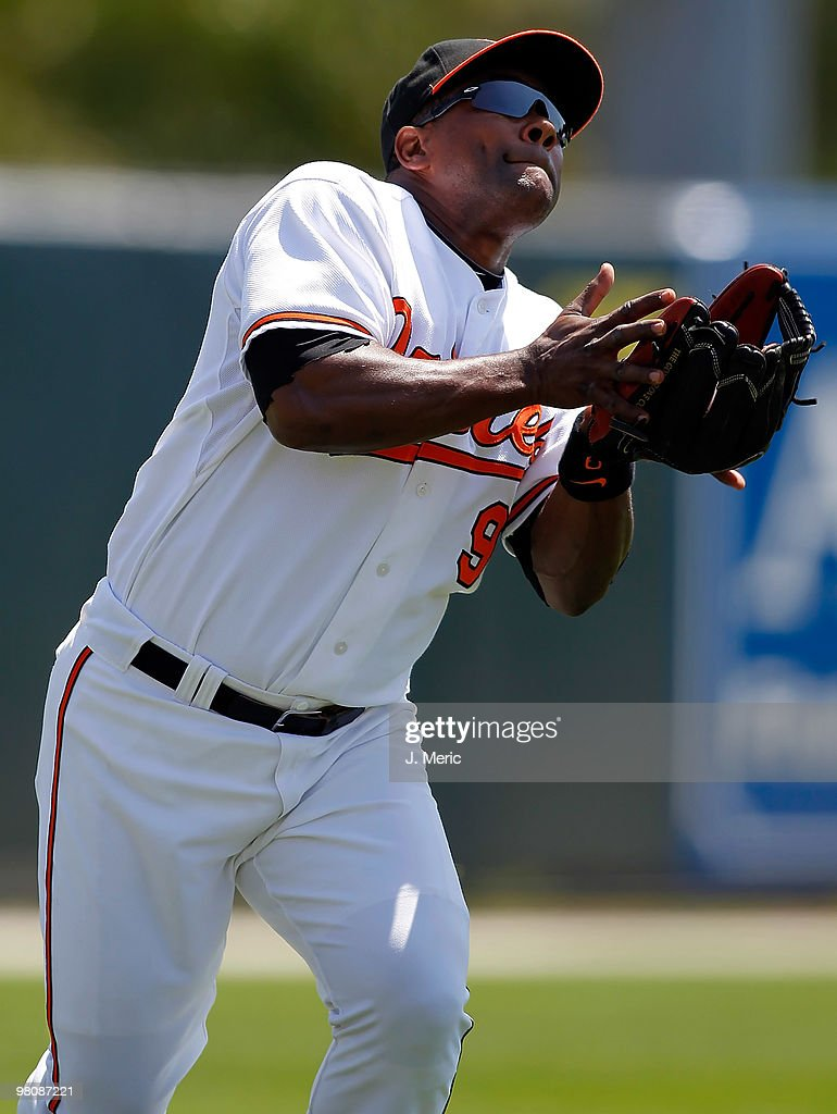Infielder <a gi-track='captionPersonalityLinkClicked' href=/galleries/search?phrase=Miguel+Tejada&family=editorial&specificpeople=202227 ng-click='$event.stopPropagation()'>Miguel Tejada</a> #9 of the Baltimore Orioles catches a fly ball for an out against the Boston Red Sox during a Grapefruit League Spring Training Game at Ed Smith Stadium on March 27, 2010 in Sarasota, Florida.