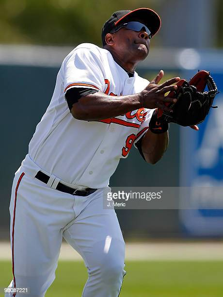 Infielder Miguel Tejada of the Baltimore Orioles catches a fly ball for an out against the Boston Red Sox during a Grapefruit League Spring Training...