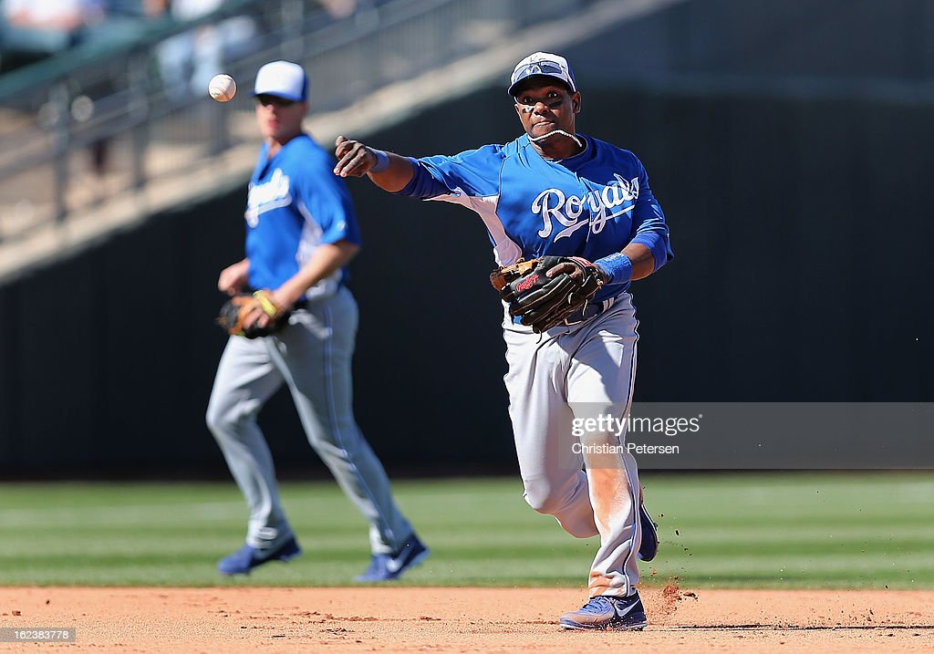 Infielder Miguel Tejada #24 of the Kansas City Royals fields a ground ball out against the Texas Rangers during the spring training game at Surprise Stadium on February 22, 2013 in Surprise, Arizona.