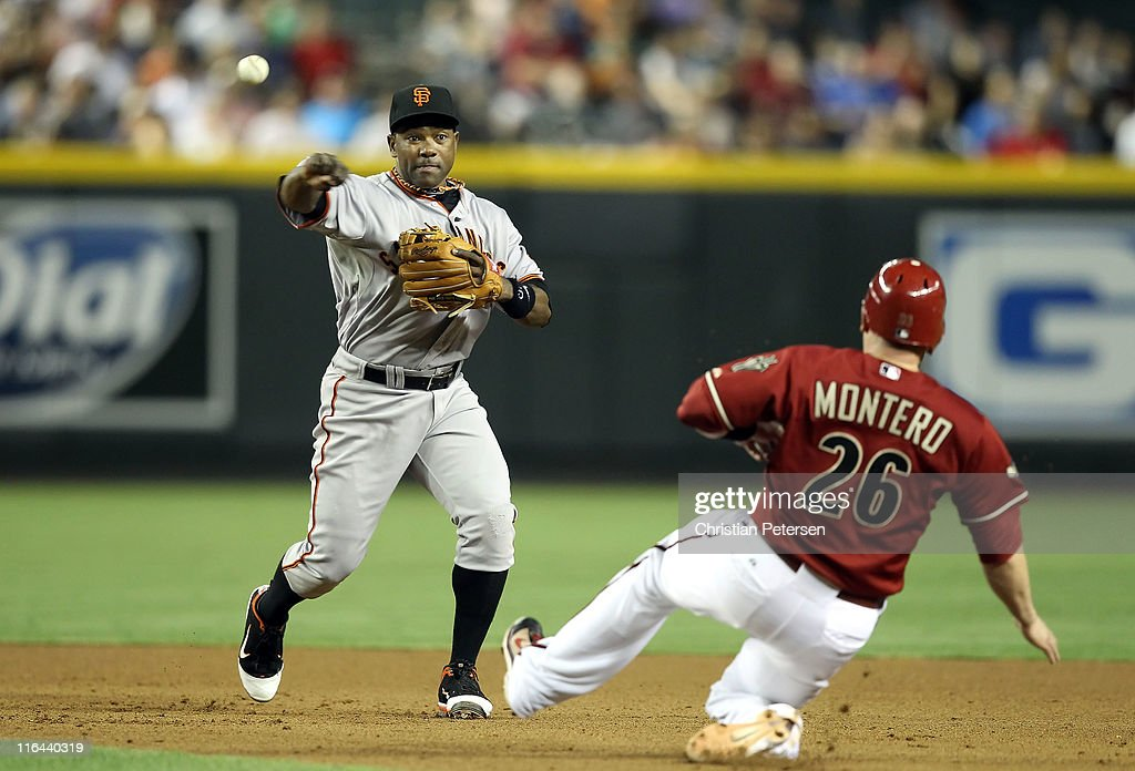 Infielder <a gi-track='captionPersonalityLinkClicked' href=/galleries/search?phrase=Miguel+Tejada&family=editorial&specificpeople=202227 ng-click='$event.stopPropagation()'>Miguel Tejada</a> #10 of the San Francisco Giants throws over the sliding <a gi-track='captionPersonalityLinkClicked' href=/galleries/search?phrase=Miguel+Montero&family=editorial&specificpeople=836495 ng-click='$event.stopPropagation()'>Miguel Montero</a> #26 of the Arizona Diamondbacks to complete a double play during the seventh inning of the Major League Baseball game at Chase Field on June 15, 2011 in Phoenix, Arizona.