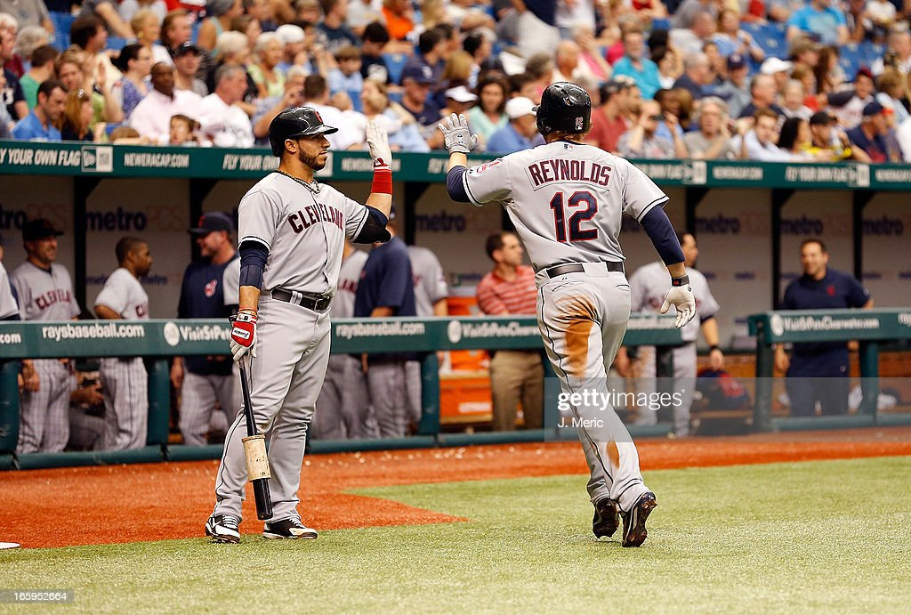 Infielder <a gi-track='captionPersonalityLinkClicked' href=/galleries/search?phrase=Mike+Aviles&family=editorial&specificpeople=4944765 ng-click='$event.stopPropagation()'>Mike Aviles</a> #4 of the Cleveland Indians congratulates <a gi-track='captionPersonalityLinkClicked' href=/galleries/search?phrase=Mark+Reynolds+-+Baseball+Player&family=editorial&specificpeople=2343799 ng-click='$event.stopPropagation()'>Mark Reynolds</a> after his seventh inning home run against the Tampa Bay Rays during the game at Tropicana Field on April 7, 2013 in St. Petersburg, Florida.