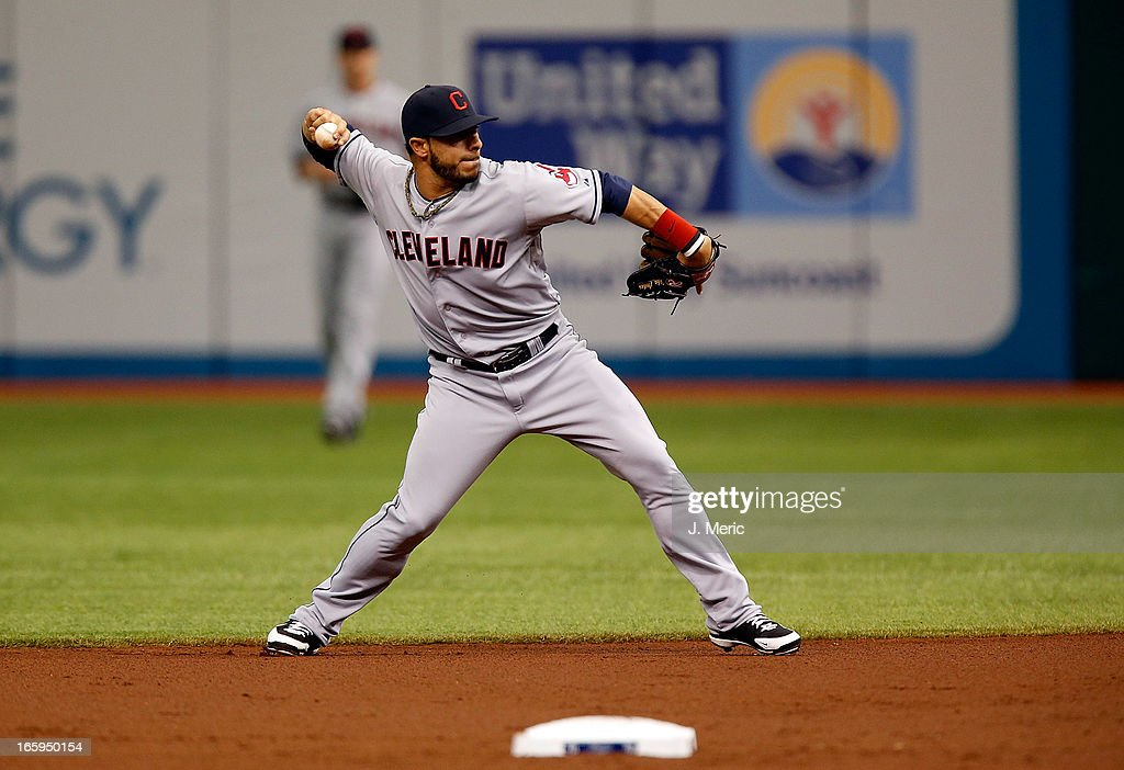 Infielder <a gi-track='captionPersonalityLinkClicked' href=/galleries/search?phrase=Mike+Aviles&family=editorial&specificpeople=4944765 ng-click='$event.stopPropagation()'>Mike Aviles</a> #4 of the Cleveland Indians throws over to first for an out against the Tampa Bay Rays during the game at Tropicana Field on April 7, 2013 in St. Petersburg, Florida.