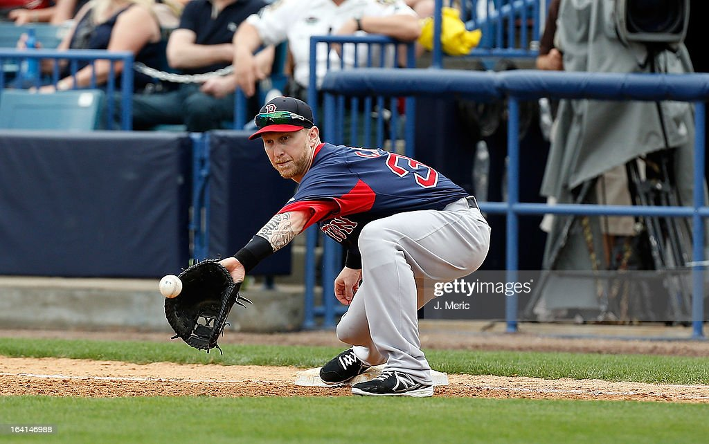 Infielder Mike Carp #38 of the Boston Red Sox takes the throw for an out against the New York Yankees during a Grapefruit League Spring Training Game at George M. Steinbrenner Field on March 20, 2013 in Tampa, Florida.