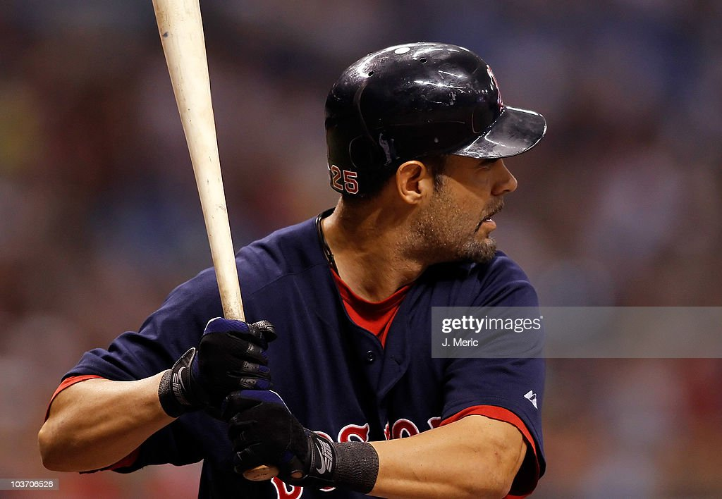 Infielder Mike Lowell of the Boston Red Sox bats against the Tampa Bay Rays during the game at Tropicana Field on August 27 2010 in St Petersburg...