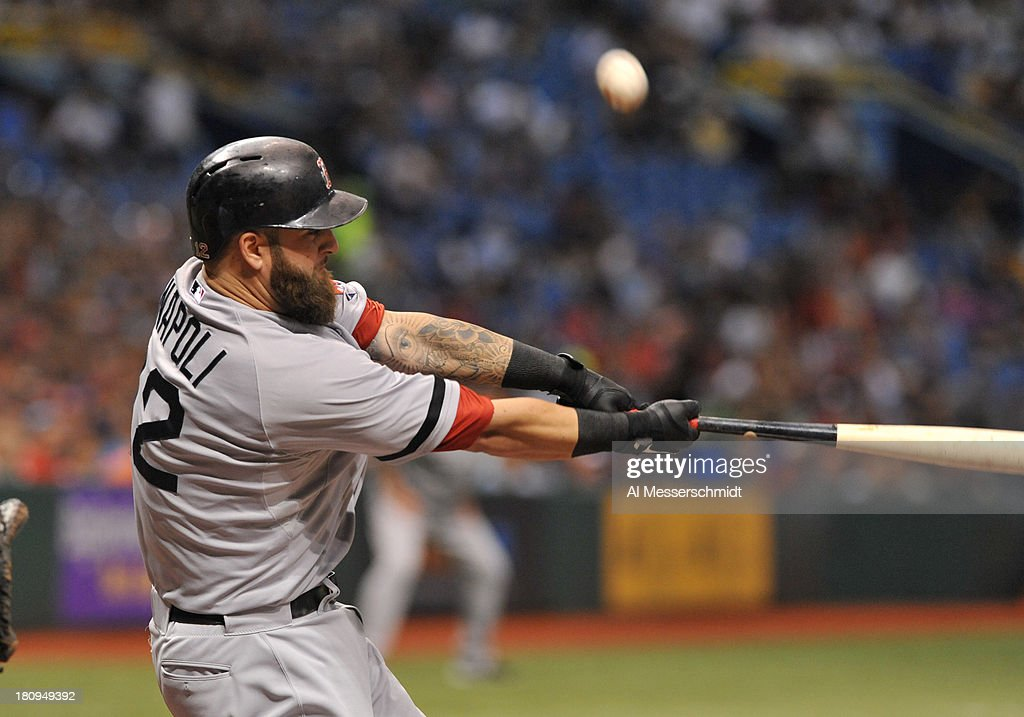 Infielder <a gi-track='captionPersonalityLinkClicked' href=/galleries/search?phrase=Mike+Napoli&family=editorial&specificpeople=525007 ng-click='$event.stopPropagation()'>Mike Napoli</a> #12 of the Boston Red Sox bats against the Tampa Bay Rays September 10, 2013 at Tropicana Field in St. Petersburg, Florida.
