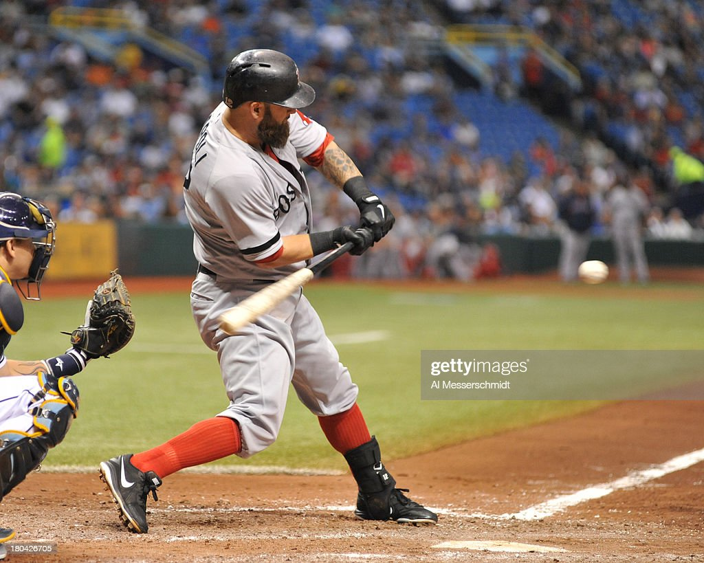 Infielder Mike Napoli #12 of the Boston Red Sox bats in the 6th inning against the Tampa Bay Rays September 12, 2013 at Tropicana Field in St. Petersburg, Florida.