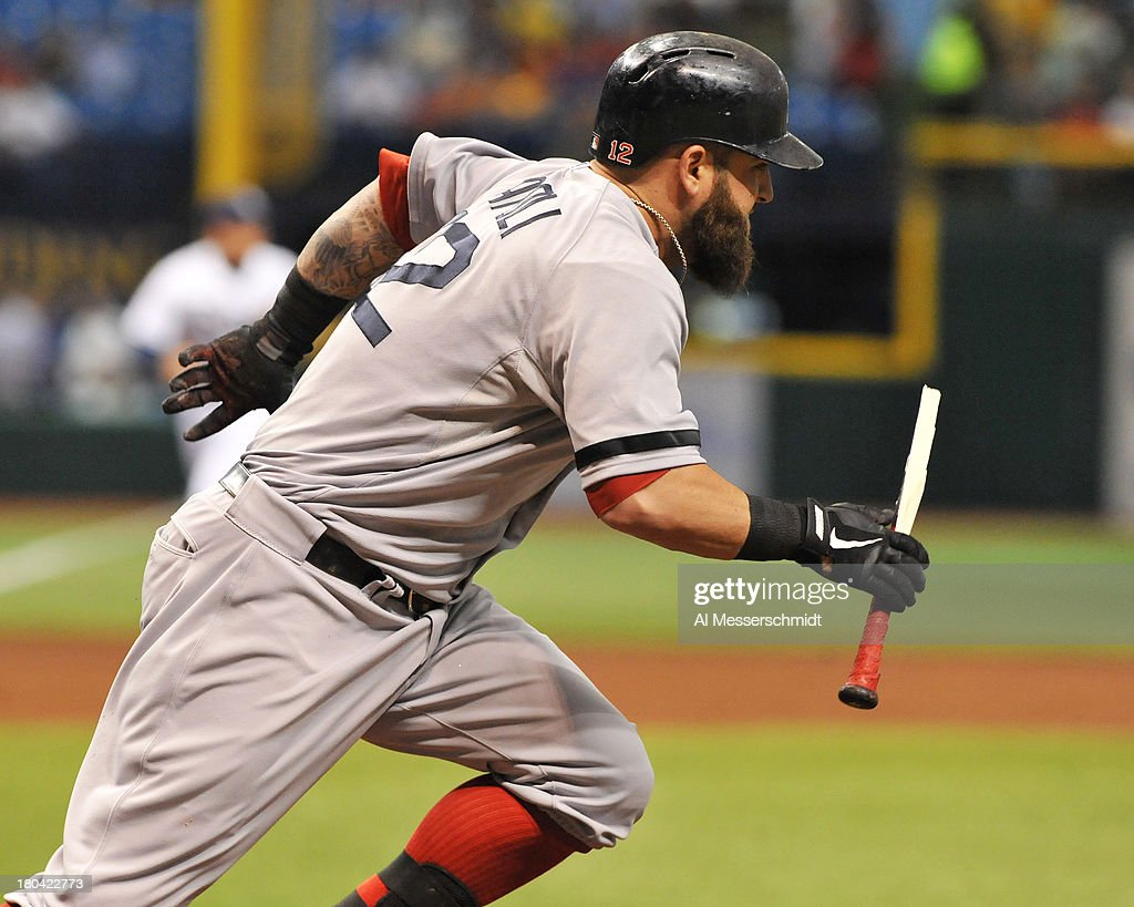 Infielder Mike Napoli #12 of the Boston Red Sox runs to first base with a broken bat against the Tampa Bay Rays September 12, 2013 at Tropicana Field in St. Petersburg, Florida.