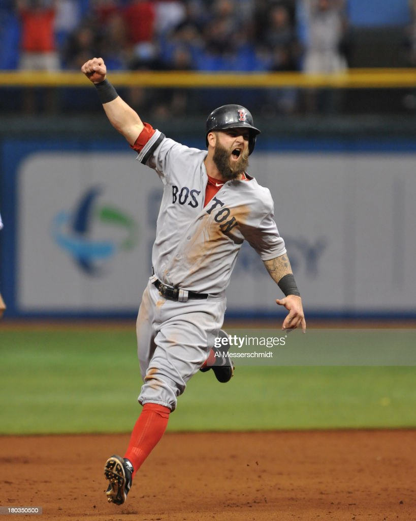 Infielder Mike Napoli #12 of the Boston Red Sox runs to home plate after a grand slam by Mike Carp against the Tampa Bay Rays in the tenth inning inning September 11, 2013 at Tropicana Field in St. Petersburg, Florida. Boston won 7 - 3.