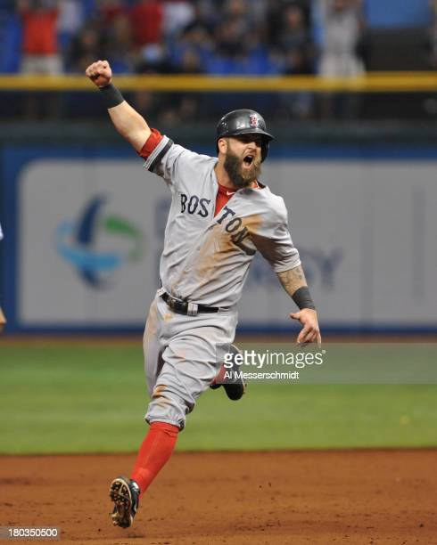 Infielder Mike Napoli of the Boston Red Sox runs to home plate after a grand slam by Mike Carp against the Tampa Bay Rays in the tenth inning inning...