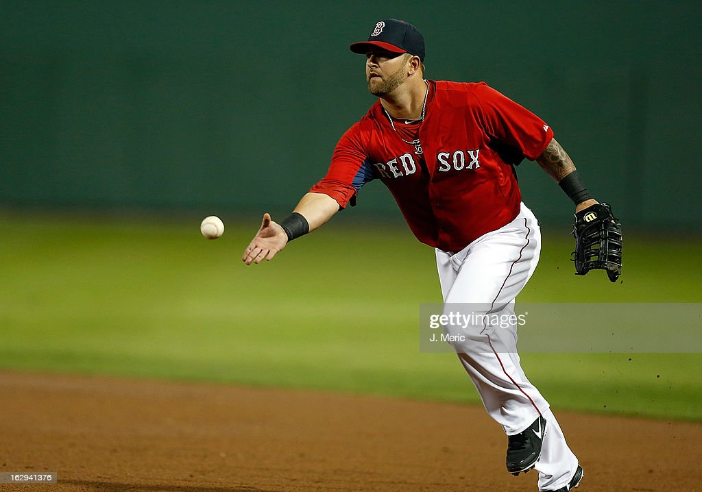 Infielder <a gi-track='captionPersonalityLinkClicked' href=/galleries/search?phrase=Mike+Napoli&family=editorial&specificpeople=525007 ng-click='$event.stopPropagation()'>Mike Napoli</a> #12 of the Boston Red Sox tosses the ball against the Pittsburgh Pirates during a Grapefruit League Spring Training Game at JetBlue Park on March 1, 2013 in Fort Myers, Florida.