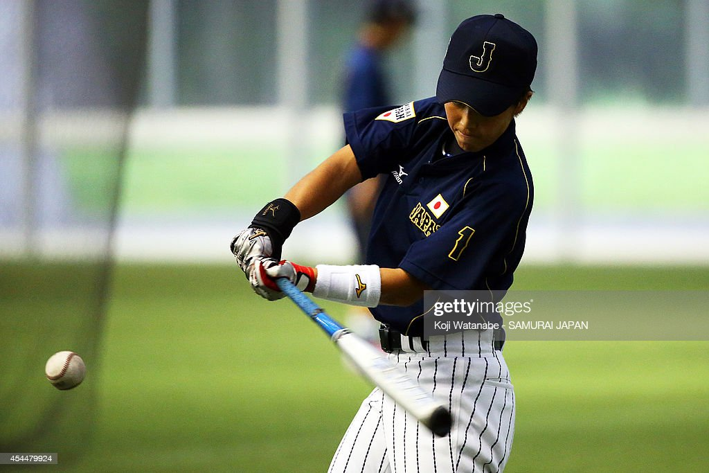 Infielder <a gi-track='captionPersonalityLinkClicked' href=/galleries/search?phrase=Miki+Atsugase&family=editorial&specificpeople=6915235 ng-click='$event.stopPropagation()'>Miki Atsugase</a> #1 of Japan in action during the IBAF Women's Baseball World Cup Group A game between Japan and Australia at Sun Marine Stadium on September 1, 2014 in Miyazaki, Japan.