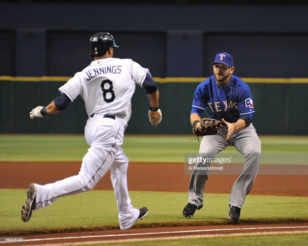 Infielder <a gi-track='captionPersonalityLinkClicked' href=/galleries/search?phrase=Mitch+Moreland&family=editorial&specificpeople=6824046 ng-click='$event.stopPropagation()'>Mitch Moreland</a> #18 of the Texas Rangers tags outfielder <a gi-track='captionPersonalityLinkClicked' href=/galleries/search?phrase=Desmond+Jennings&family=editorial&specificpeople=5974085 ng-click='$event.stopPropagation()'>Desmond Jennings</a> #8 of the Tampa Bay Rays after a bunt attempt September 18, 2013 at Tropicana Field in St. Petersburg, Florida.
