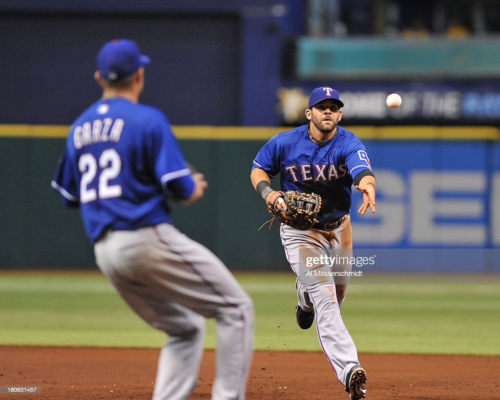 Infielder <a gi-track='captionPersonalityLinkClicked' href=/galleries/search?phrase=Mitch+Moreland&family=editorial&specificpeople=6824046 ng-click='$event.stopPropagation()'>Mitch Moreland</a> #18 of the Texas Rangers tosses a ball to pitcher <a gi-track='captionPersonalityLinkClicked' href=/galleries/search?phrase=Matt+Garza&family=editorial&specificpeople=835829 ng-click='$event.stopPropagation()'>Matt Garza</a> #22 against the Tampa Bay Rays September 16, 2013 at Tropicana Field in St. Petersburg, Florida.