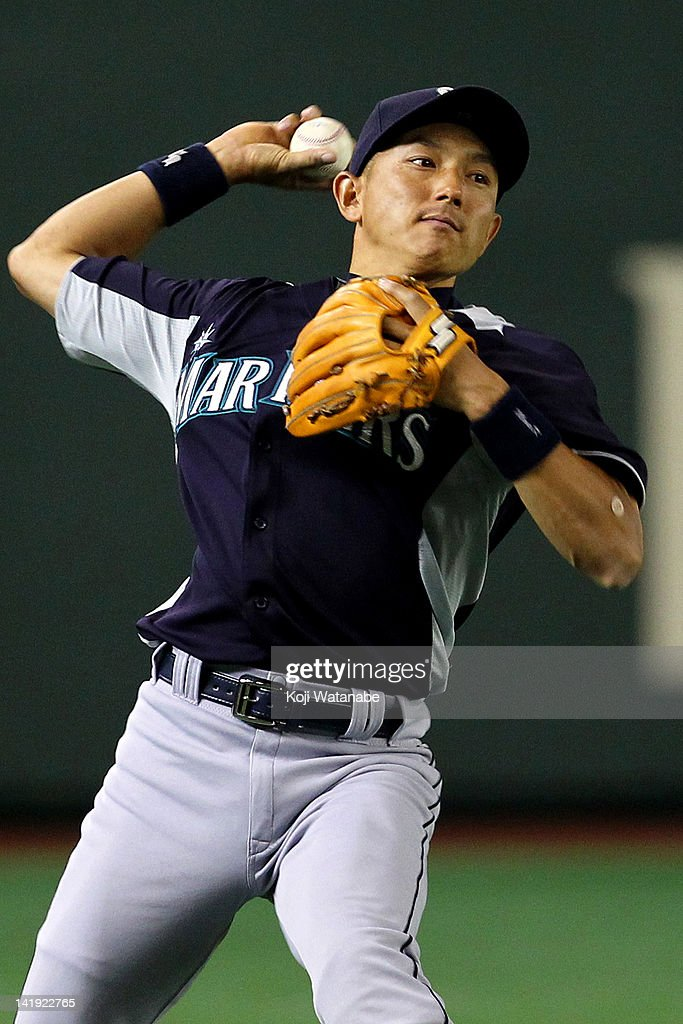 Infielder <a gi-track='captionPersonalityLinkClicked' href=/galleries/search?phrase=Munenori+Kawasaki&family=editorial&specificpeople=690355 ng-click='$event.stopPropagation()'>Munenori Kawasaki</a> #61 of Seattle Mariners in action during in the bottom half of the fifth inning the pre season game between Yomiuri Giants and Seattle Mariners at Tokyo Dome on March 26, 2012 in Tokyo, Japan.