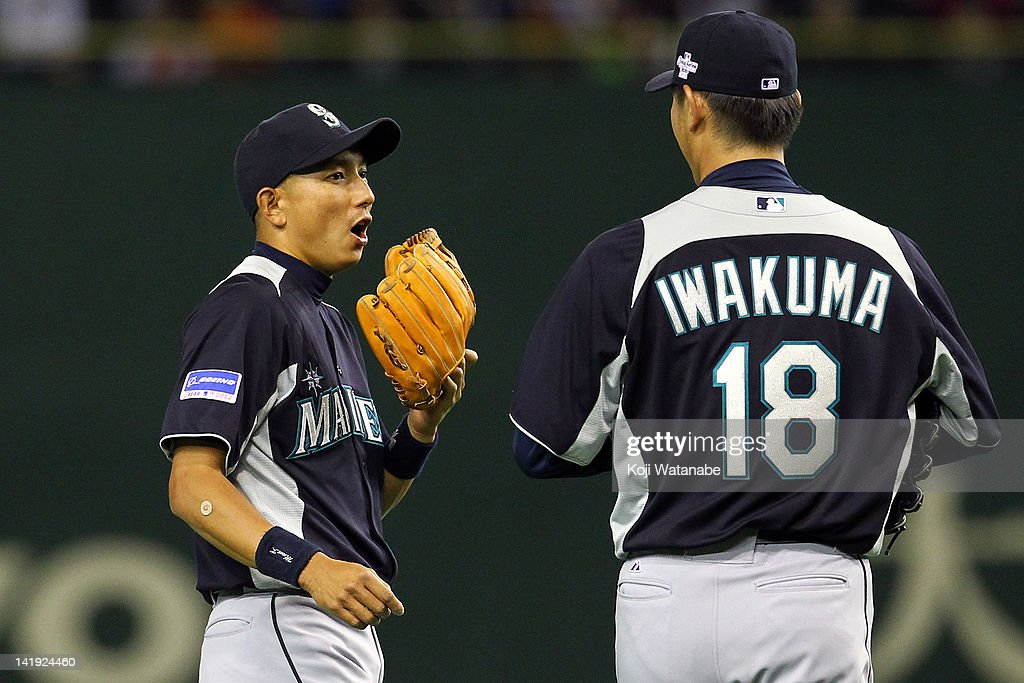 Infielder Munenori Kawasaki #61 of Seattle Mariners looks on during the pre season game between Yomiuri Giants and Seattle Mariners at Tokyo Dome on March 26, 2012 in Tokyo, Japan.