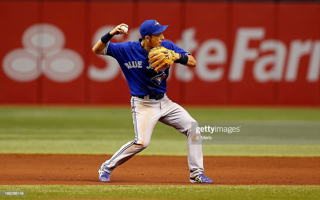 Infielder Munenori Kawasaki #66 of the Toronto Blue Jays throws over to second for an out against the Tampa Bay Rays during the game at Tropicana Field on May 7, 2013 in St. Petersburg, Florida.