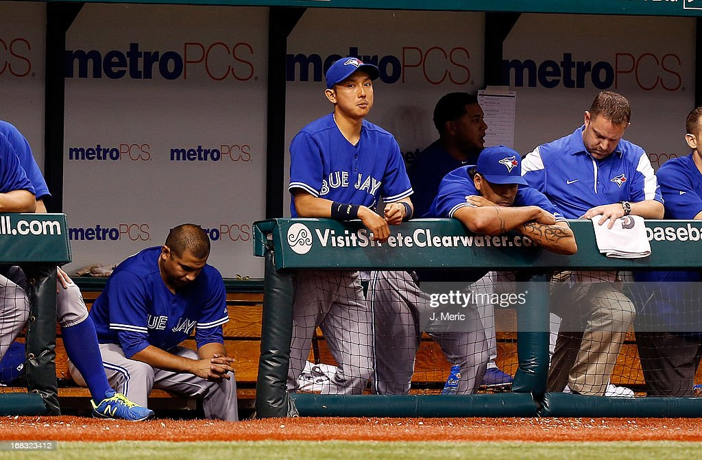Infielder <a gi-track='captionPersonalityLinkClicked' href=/galleries/search?phrase=Munenori+Kawasaki&family=editorial&specificpeople=690355 ng-click='$event.stopPropagation()'>Munenori Kawasaki</a> #66 of the Toronto Blue Jays watches his team from the dugout against the Tampa Bay Rays during the game at Tropicana Field on May 8, 2013 in St. Petersburg, Florida.
