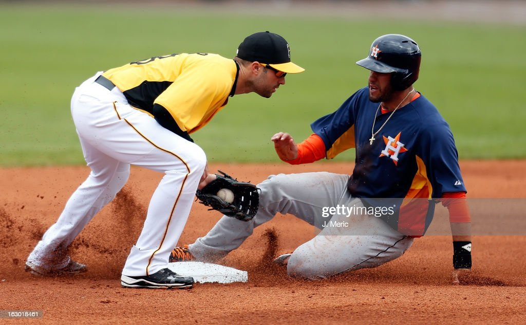Infielder Neil Walker #18 of the Pittsburgh Pirates tags out <a gi-track='captionPersonalityLinkClicked' href=/galleries/search?phrase=J.D.+Martinez&family=editorial&specificpeople=7520024 ng-click='$event.stopPropagation()'>J.D. Martinez</a> #14 of the Houston Astros on a steal attempt during a Grapefruit League Spring Training Game at McKechnie Field on March 3, 2013 in Bradenton, Florida.