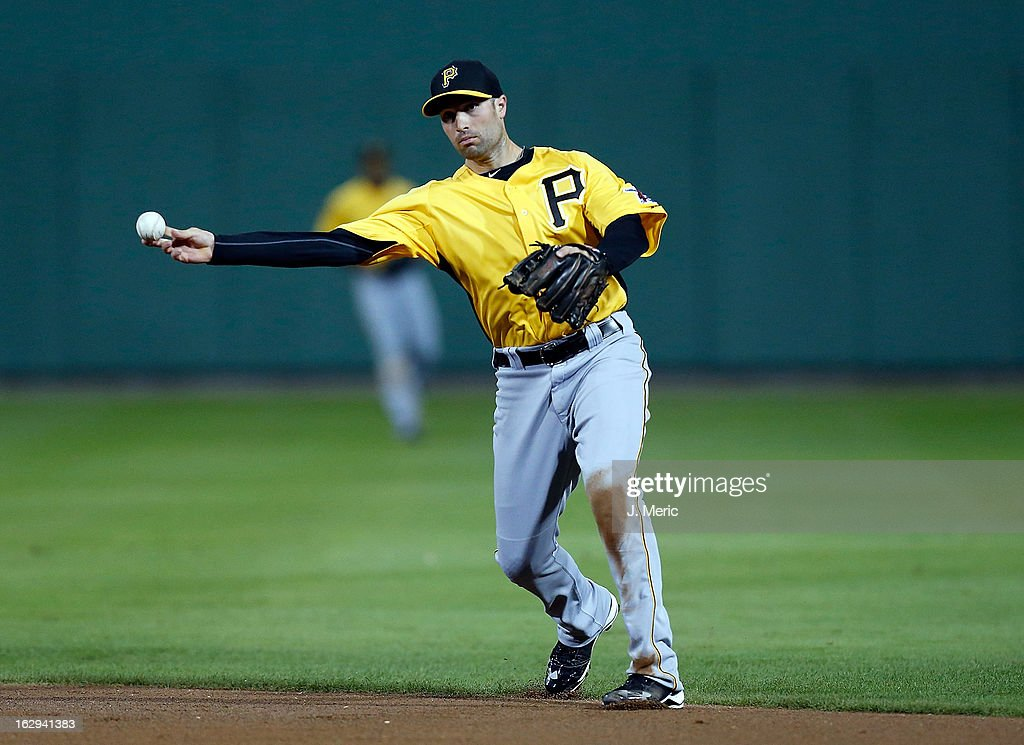 Infielder Neil Walker #18 of the Pittsburgh Pirates throws over to first for an out against the Boston Red Sox during a Grapefruit League Spring Training Game at JetBlue Park on March 1, 2013 in Fort Myers, Florida.