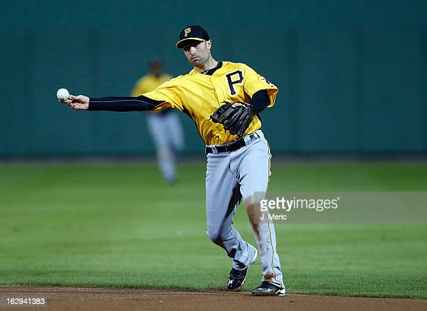 Infielder Neil Walker of the Pittsburgh Pirates throws over to first for an out against the Boston Red Sox during a Grapefruit League Spring Training...