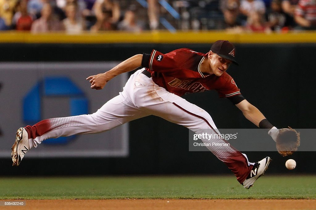 Infielder Nick Ahmed of the Arizona Diamondbacks fields a ground ball out against the San Diego Padres during the fourth inning of the MLB game at...