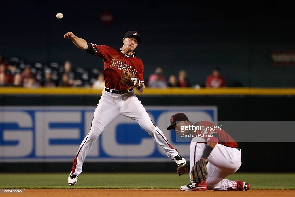 Infielder Nick Ahmed #13 of the Arizona Diamondbacks fields a ground ball out against the San Diego Padres during the fourth inning of the MLB game at Chase Field on May 29, 2016 in Phoenix, Arizona.