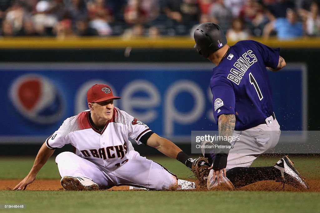 Infielder Nick Ahmed #13 of the Arizona Diamondbacks tags out Brandon Barnes #1 of the Colorado Rockies as he attempts to steal second base during the seventh inning of the MLB game at Chase Field on April 6, 2016 in Phoenix, Arizona.
