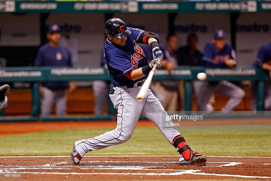 Infielder <a gi-track='captionPersonalityLinkClicked' href=/galleries/search?phrase=Nick+Swisher&family=editorial&specificpeople=206417 ng-click='$event.stopPropagation()'>Nick Swisher</a> #33 of the Cleveland Indians bats against the Tampa Bay Rays in the first inning during the game at Tropicana Field on April 5, 2013 in St. Petersburg, Florida.