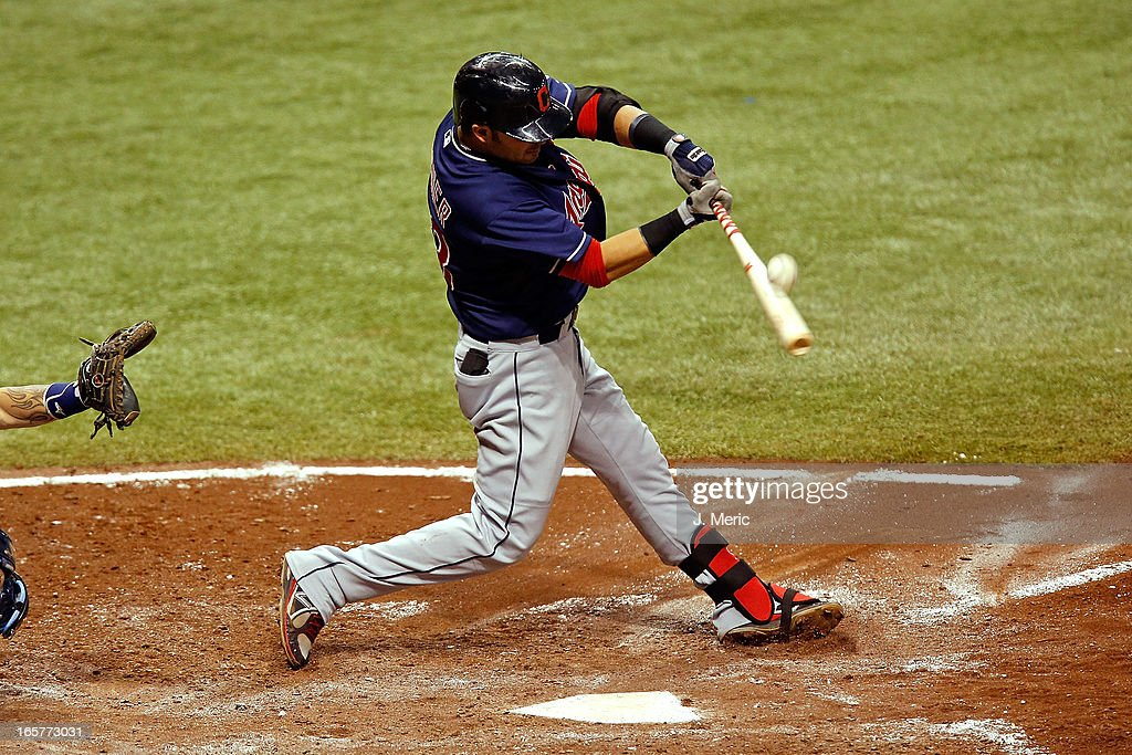 Infielder <a gi-track='captionPersonalityLinkClicked' href=/galleries/search?phrase=Nick+Swisher&family=editorial&specificpeople=206417 ng-click='$event.stopPropagation()'>Nick Swisher</a> #33 of the Cleveland Indians fouls off a pitch against the Tampa Bay Rays during the game at Tropicana Field on April 5, 2013 in St. Petersburg, Florida.