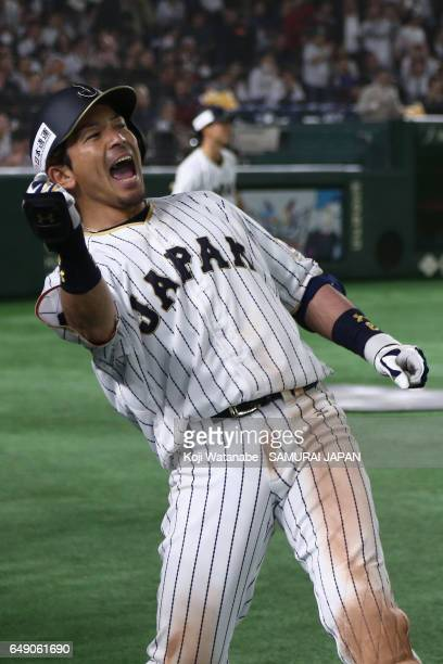 Infielder Nobuhiro Matsuda of Japan celebrates after hitting a threerun homer to make it 61 in the bottom of the fifth inning during the World...