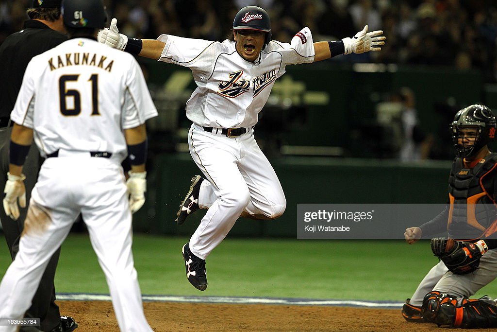 Infielder <a gi-track='captionPersonalityLinkClicked' href=/galleries/search?phrase=Nobuhiro+Matsuda&family=editorial&specificpeople=8673842 ng-click='$event.stopPropagation()'>Nobuhiro Matsuda</a> #5 of Japan celebrates after scoring in the bottom half of the eighth inning during the World Baseball Classic Second Round Pool 1 game between Japan and the Netherlands at Tokyo Dome on March 12, 2013 in Tokyo, Japan.