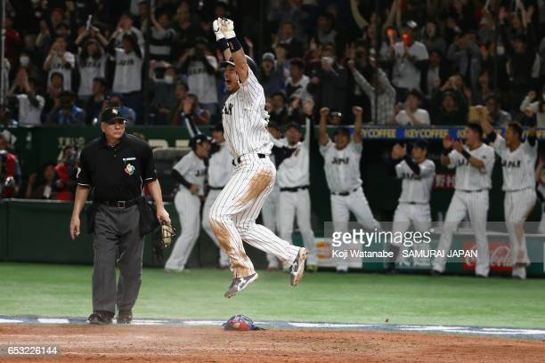 Infielder Nobuhiro Matsuda of Japan celebrates scoring a run by a sacrifice fly of Outfielder Seiichi Uchikawa in the bottom of the eighth inning...