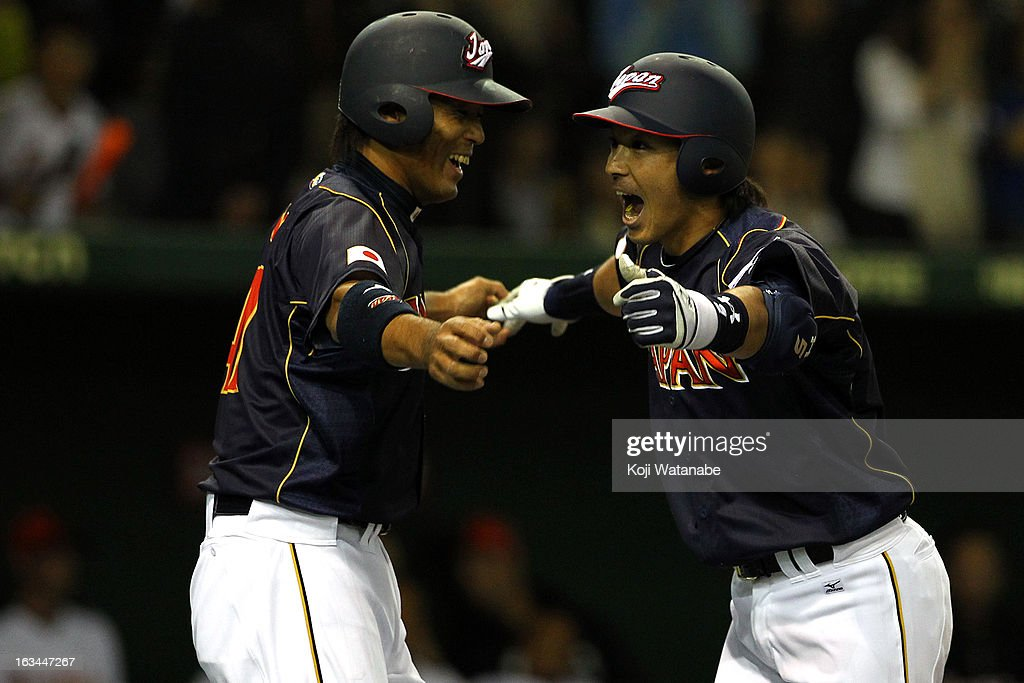 Infielder Nobuhiro Matsuda #5 (R) of Japan celerates after scoring hits a two run home run in the bottom half of the second inning during the World Baseball Classic Second Round Pool 1 game between Japan and the Netherlands at Tokyo Dome on March 10, 2013 in Tokyo, Japan.