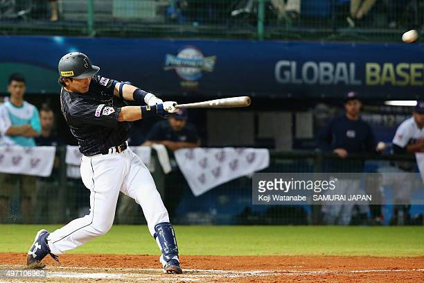 Infielder Nobuhiro Matsuda of Japan hits a grand slum in the top of seventh inning during the WBSC Premier 12 match between the United States and...