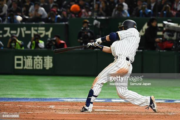 Infielder Nobuhiro Matsuda of Japan hits a threerun homer to make it 16 in the bottom of the fifth inning during the World Baseball Classic Pool B...