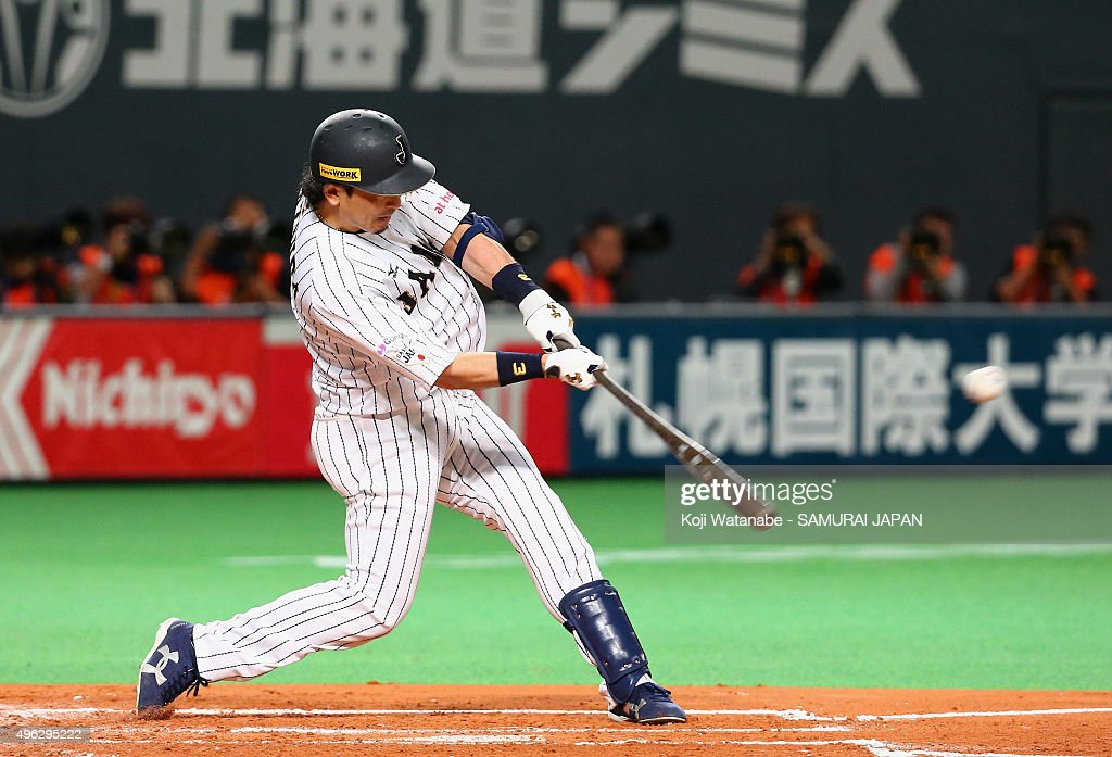 Infielder Nobuhiro Matsuda #3 of Japan htis a single in the bottom of the second inning during the WBSC Premier 12 match between Japan and South Korea at the Sapporo Dome on November 8, 2015 in Sapporo, Hokkaido, Japan.